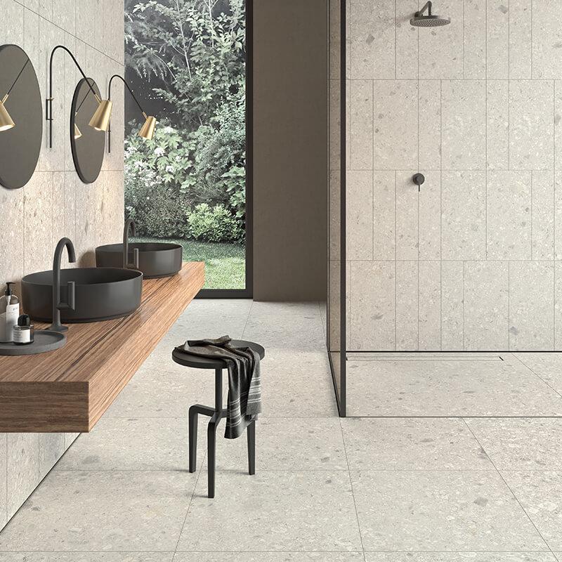 white stone wall tile floor bathroom shower ontario